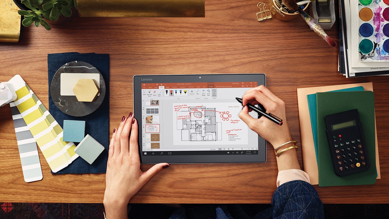 Woman planning designs on tablet
